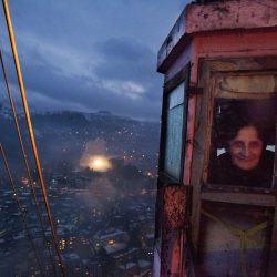 Georgia. Chiatura City. A cable car controller on her night shift. Cable cars are dated back at Soviet era. It was build to tranport mineworkers up and down the mine.  60 years later it is still running and used as public transportation.