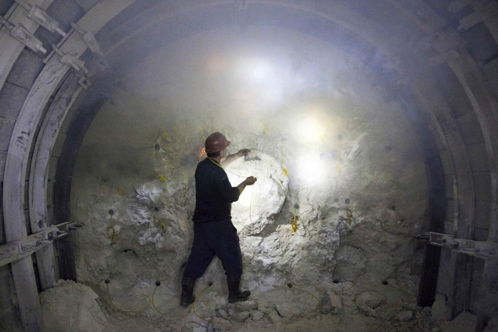 Georgia. Chiatura City. Inside the mine tunnel. Mineworker startes the fire on the explosions. We have to count to 30 and run far away before it blows up.