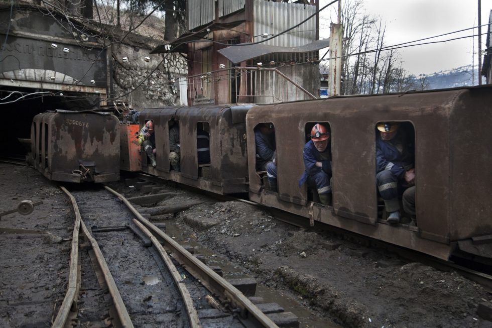 GEORGIA. Miners in a mining train on their way to the tunnel in 40 m depth. Miners work 12 hours everyday with a monthly salary of approximately $300.